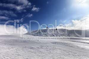 Gondola lift and ski slope at sun day