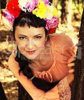 woman in wreath of roses on her head