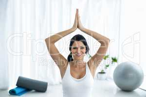 Pregnant woman in prayer position on exercise ball