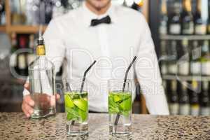 Bar tender making cocktails