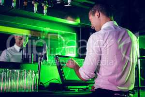 Waiter preparing a bill