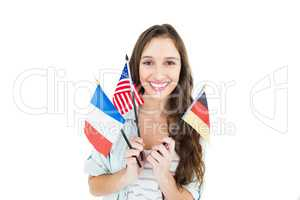 Female student holding several flags