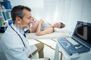 Pregnant woman receiving ultrasound treatment