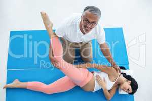 Doctor giving physiotherapy to pregnant woman