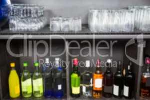 Alcohol bottles kept in a shelf