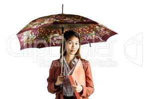 Businesswoman with an umbrella holding a binder