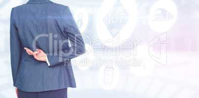 Composite image of businesswoman with fingers crossed behind her