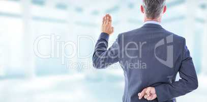 Composite image of rear view of businessman taking oath with fin