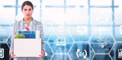 Composite image of fired businesswoman holding box of belongings