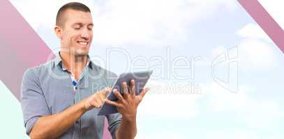 Composite image of businessman using digital tablet over white b