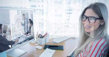 Composite image of attractive photo editor working on computer