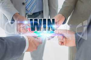 Success against business colleagues holding piece of puzzle