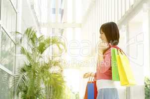 Asian woman holding shopping bags