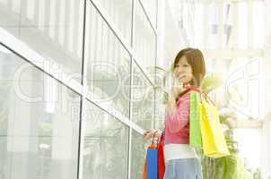 Asian female holding shopping bags
