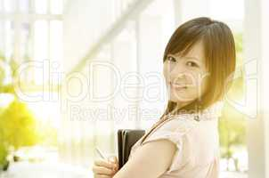 Young Asian female executive at office