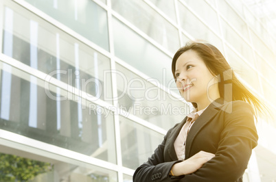 Young Asian business woman looking away