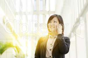 Young Asian business woman calling on phone