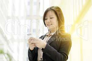 Young Asian business woman using smartphone