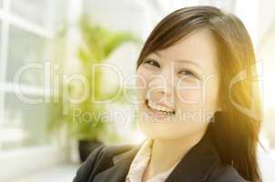 Cheerful young Asian business woman