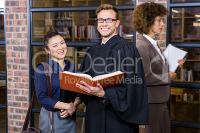 Lawyer and businesswoman standing near library