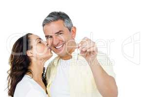 Portrait of happy couple holding home keys
