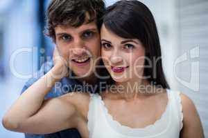Portrait of couple in mall
