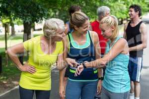 Marathon female athletes setting heart rate watch