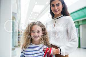 Happy mother and daughter in shopping mall