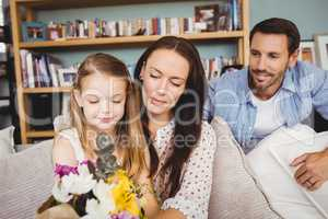 Smiling family with flower bouquet