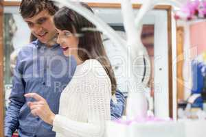 Happy couple shopping in mall