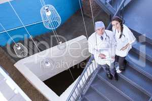 Portrait of doctors standing on staircase