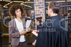 Lawyer interacting with businesswoman