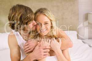 Nice man cuddling his girlfriend