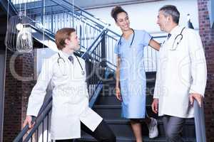 Medical team interacting with each other on staircase