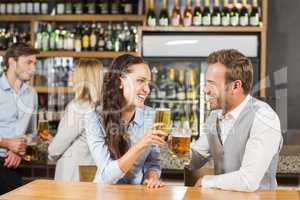 Couples looking at each other while holding beer