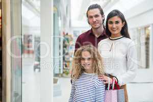 Portrait of happy family in shopping mall