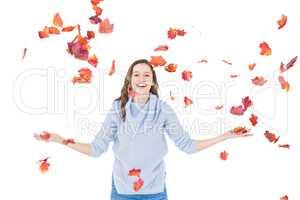 Happy woman throwing leaves