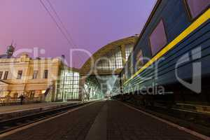 The train on the platform of railroad station in Lviv .