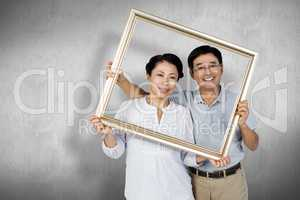 Composite image of older asian couple with frame