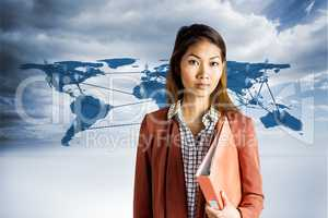 Composite image of businesswoman holding a binder