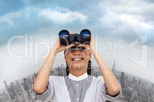 Composite image of visionary businesswoman looking through binoc
