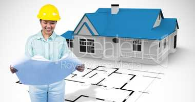 Composite image of architect reading a plan with yellow helmet