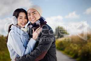 Composite image of portrait of couple embracing