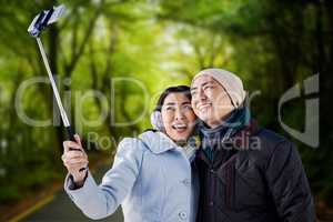 Composite image of smiling couple taking selfie