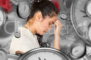 Composite image of casual upset businesswoman with head bowed
