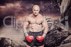 Composite image of portrait full length of bald boxer flexing mu