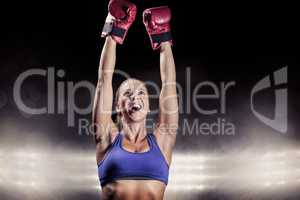 Composite image of winning fighter with arms raised
