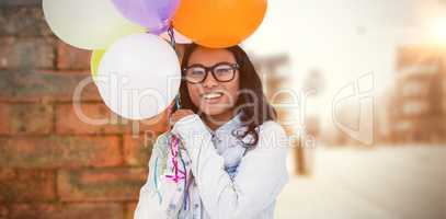 Composite image of asian woman holding colorful balloons