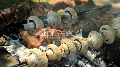 Meat and mushrooms on a barbecue