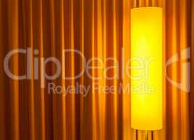 floor lamp ahead curtain on the left